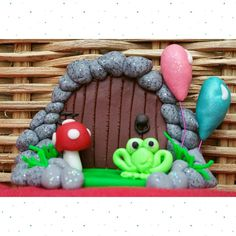 Handmade fairy door with balloons, toadstool and frog