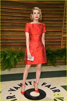 Emma Roberts  - Vanity Fair Oscars Party 2014. Emma is wearing a Fendi dress, custom Brian Atwood shoes, Dior Fine Jewelry rings, Chimento earrings, and a Swarovski bag.