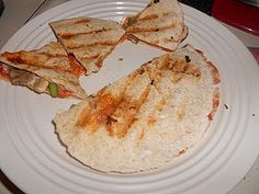 Pizza + Quesadilla =Quick and easy kids meal!  All kids love pizza, but this is much healthier!