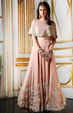 //Astha Narang blush colored lehenga with gold details and cape top