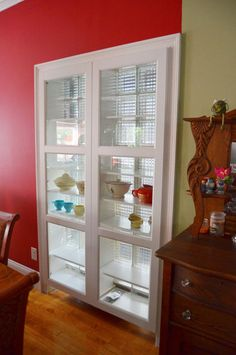 In order to make good use of their limited space, Terry and Jo cut into the walls to recess their furniture. Backed with glass block and fronted with Ikea cabinet doors, this cabinet provides additional storage for dishware. (There is also a picture of four Ikea CD racks inserted between wall studs for storage.)