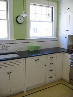 Marmoleum floor (love the border) in vintage inspired kitchen.