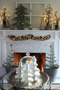 See how to make this festive ornament garland for your Christmas mantel eclecticallyvintage.com