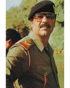 Beard Logo, Iraqi Army, Saddam Hussein, Baghdad Iraq, Apple Wallpaper Iphone, Dc Comics, Gun, Mens Sunglasses, Photo And Video