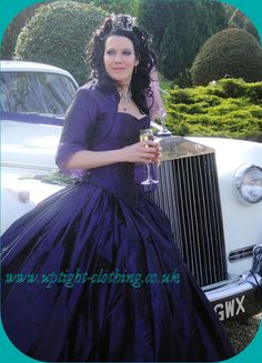 STUNNING GOTHIC PURPLE SILK TAFFETA CORSETED WEDDING DRESS OR BRIDESMAID DRESS WITH BLACK EMBRIODARY, BY UPTIGHT CLOTHING, JANICE WHITEHORN.