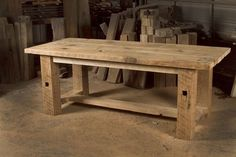 The Lucian Dining Table is handcrafted from reclaimed tamerack. Top is comprised of 3 floor boards each 12 inches wide. Legs are 6 inches x 6 inches rough sawn barn beams. Original square mortises shown on the legs. Trestle to add extra strength. The entire table is built from the same species of lumber from the same barn, which gives it a uniform look. Natural sanded finish.