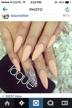Nude/pinkish stilletto nails