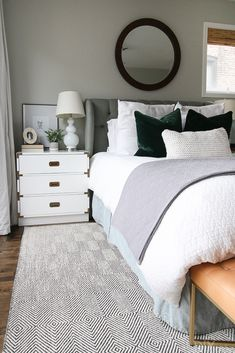 These velvet green pillows from @Article give this neutral bedroom a luxe look. Love the pop of color against the all white bedding #graybedroom #neutralbedroom