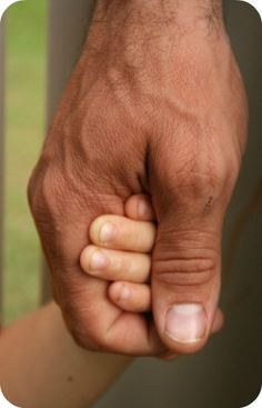 Take pictures of son's hands holding their son's hands - same for daughters, etc