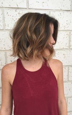Aveda Artist Lynzi created a stunning brunette balayage on wavy short hair.