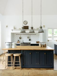 Black matte cabinets with butcher block counter