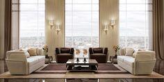 Кожаные диван и кресло с декоративным золотым элементом.