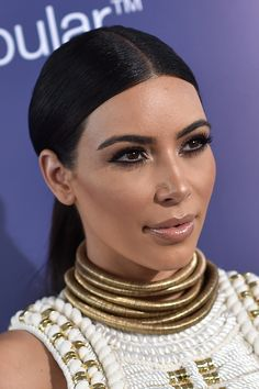 A stack of gold chokers completed the look, giving Kim kind of a Cleopatra vibe, no?