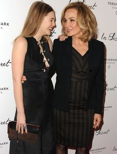 Jessica Lange and Elizabeth Olsen arrive at the Los Angeles premiere of 'In Secret' at ArcLight Hollywood on Feb 6, 2014 in Hollywood, CA