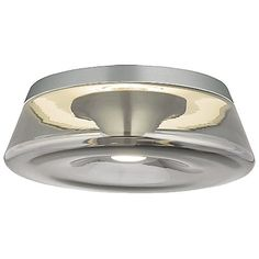 The Tech Lighting Ambist Flushmount alludes sophistication and high quality, constructed from a hand-blown glass shade and seamlessly aligning with the metal body. Two LED light modules provide a powerful yet calm center beam while there is also an indirect ring of light providing visual contrast through the translucent glass.
