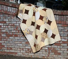 A 10 Minute Block quilt using Lily & Will in yellows and browns.  Lovely.