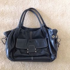 KATE SPADE black purse Kate Spade black purse with green interior.  Leather in really good used condition--just some wear on bottom.  Interior good but a little dirty with some pen marks.  Beautiful purse that's very large and lots of room.  Will post additional pic kate spade Bags Satchels