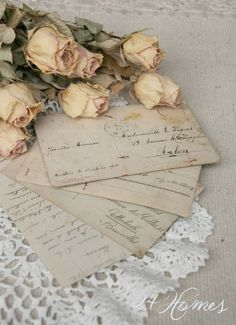 Old fashioned hand written love letters and roses show romance.