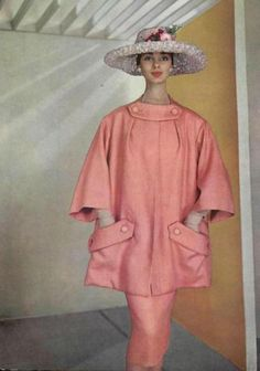 Model wearing a rose coloured ensemble by Dior for L'Officiel, 1956.