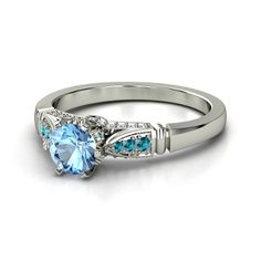 Many other options from Gemvara.com, all customizable...basically, I like a ring with side stones, or an engraved/artsy band, but something very feminine, and not bold.  Blue topaz is gorgeous, and the London Blue has more of a teal color to it.d
