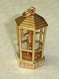 Vintage 14K Rose Gold English Bobby Traffic Cop Cage Charm or Pendant, via Etsy.