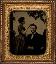 Never seen anything like this before! ca. 1860, [portrait a woman combing hair of a seated gentleman]