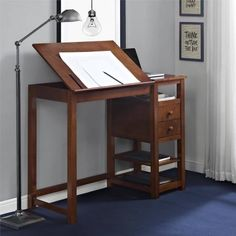 Let your creativity run wild with the versatile Dorel Living Drafting Counter Height Desk. Crafted with a sturdy wood construction and a mature espresso finish, this desk ensures sturdiness and years