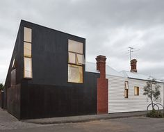 Japanese influence. Black painted plywood exterior