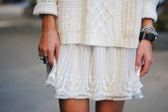 Contrasts: big comfy sweater, fragile skirt, chunky bracelets. - L.