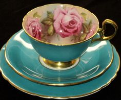 Aynsley Bone China Teacup, Saucer and Plate set in turquoise with gold rim and handle and roses decor inside cup