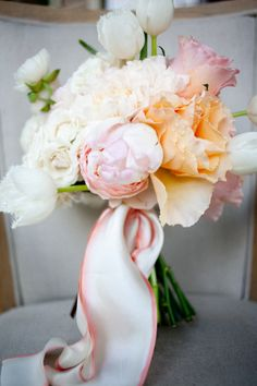 pale pink and peach, with a delicate ribbon.