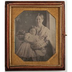 Lot of 7.  A sixth plate daguerreotype of a mother/grandmother and young girl with flower baskets, under an early mat, housed in an early case stamped by the photographer, Plumbe. Most likely John Plumbe, Jr.,one of the earliest practit...