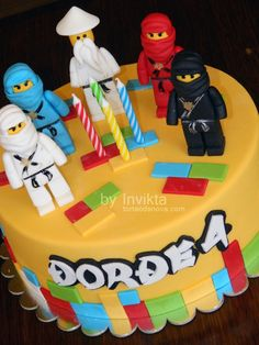 Ninjago cake. Riley has requested a blue ninja cake with the Green, Gold and Red figurines on it!