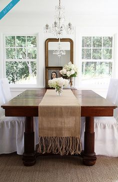 Love the white walls in dining room with deep furniture - lovely.