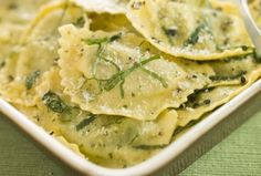 1 pound mushrooms  2 packages (10 ounces each) frozen spinach, thawed  3 Tablespoons olive oil  4 cloves garlic, minced  1 pound cheese filled ravioli  3 Tablespoons butter  1½ teaspoons oregano  ¼ teaspoon salt  ¼ teaspoon pepper  ¼ cup grated Parmesan cheese
