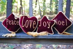 """Though these items have been previously used, they are like new with no defects whatsoever.<br/><br/>These beautiful red velvet pillow ornaments are trimmed with gold cord and have gold tassels. The words """"Love"""", """"Noel"""", """"Joy"""", and """"Peace"""" are stitched on them in gold."""