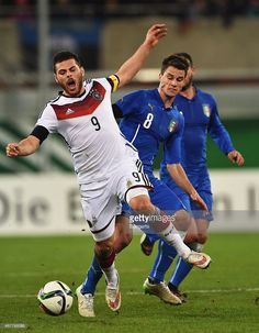 Kevin Volland of Germany is challenged by Lorenzo Crisetig of Italy during a U21 International...