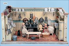 German doll kitchen, 69 cm wide, 35 cm high, 36.5 deep, permanently installed shelves, cupboards, 1 display case, original wallpaper. Floor paper badly worn. Original paint, with a wealth of accessories, tinplate -, ceramic, porcelain and wood parts, with stove. From a German toy auction site.