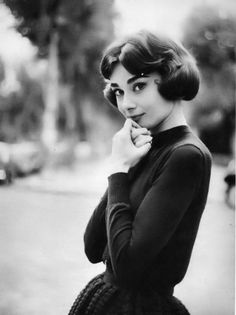 A very young Audrey Hepburn photographed by Sam Shaw, 1957.