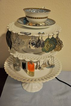 my mother found the dessert saucers at a garage sale, we hot glued them together to make an adorable jewelry holder. tea cup on top was given to me by my grandma.
