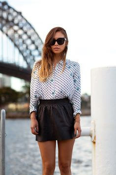 Rumi Neely - A leather mini softens its edge when paired with a retro blouse. #rumineely #mbfwu #streetstyle