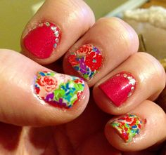 Pink nails with floral wrap accent nails. By Jen T.