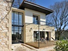 The architect José Marcos realized a modern extension for an old village school transformed into a dwelling. The two independent volumes are connected by a patio with the qualities … Source by ameliefourche Style At Home, Architecture Plan, Interior Architecture, Archi Design, House Extensions, Home Fashion, My House, House Plans, New Homes