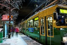 A green tram in Helsinki.