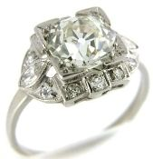 Late Art Deco era, circa 1930, platinum engagement ring set with an old European cut diamond weighing 1.70 carats of VS1 clarity and K color.