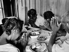 Sharecropper Lonnie Fair and his family praying before meal. Photograph by Alfred Eisenstaedt. Scott, Mississippi,1936.