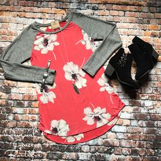 THE KATIE FLORAL TUNIC $31.50    Material: 98% Polyester / 8% SpandeX    Bring Spring! Long sleeve floral and stripe print Tunic top.    Color: Coral/Black    Available sizes: Small (0-5), Medium (6-9), Large (10-13). (TTS)     | Shop this product here: spree.to/bnm7 | Shop all of our products at http://spreesy.com/JewelsByScarlett    | Pinterest selling powered by Spreesy.com