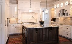 Berenson Baroque Collection in Verona Bronze. Designer Kitchens and Custom Interiors by Walker Woodworking Photography by Stacey Walker