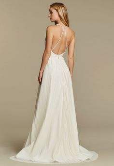 """""""Cosmos"""" gown. Ivory pleated net A-line bridal gown, draped V-neck bodice with delicate straps and beaded applique, full pleated skirt. Back View"""