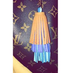 Accessories are like vitamins and as such you should use them liberally. NEW ARRIVAL: tri color fringe keychain|bagcharm #lv #blue #trendy #bagcandy #shop